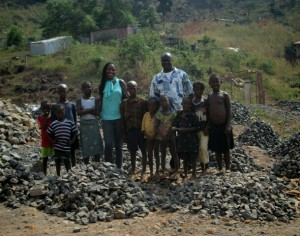 Foday & Joy with kids at stone mine