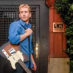 Peter Maybarduk with his guitar at Public Citizen